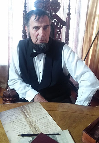 lincoln at desk